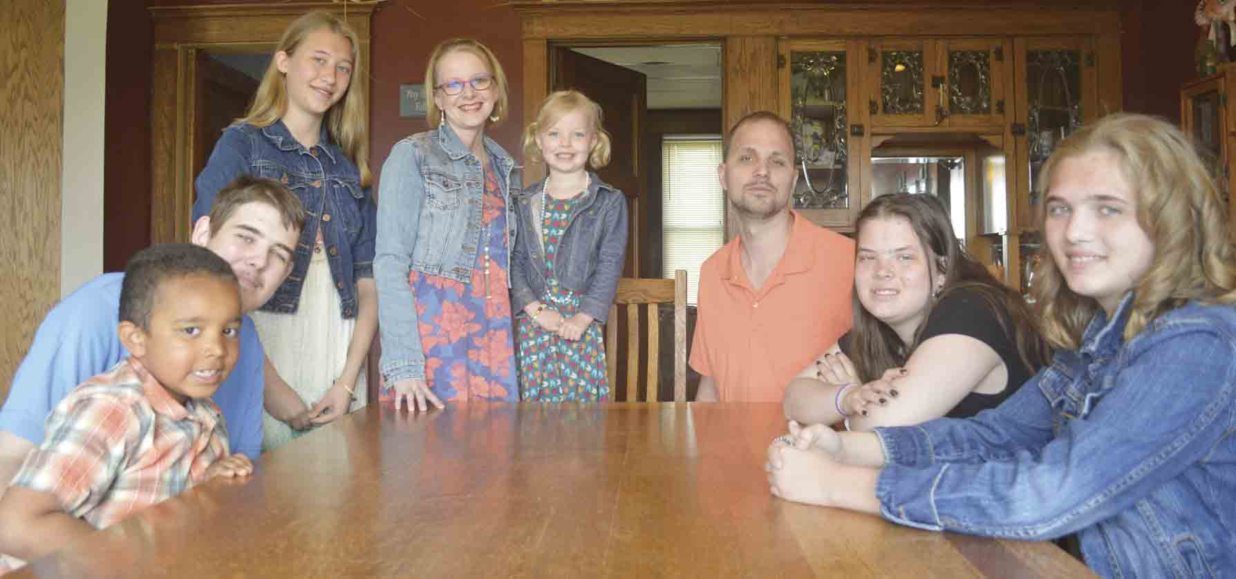 """For (l-r) Trevin, William, Samantha, Heidi, Ella, Kevin, Dawn, and Anita Bohr, the term """"family"""" is one that developed among the eight a little differently from most. With all six adopted children, the tight-knit crew is looking forward to another special Mother's Day this..."""