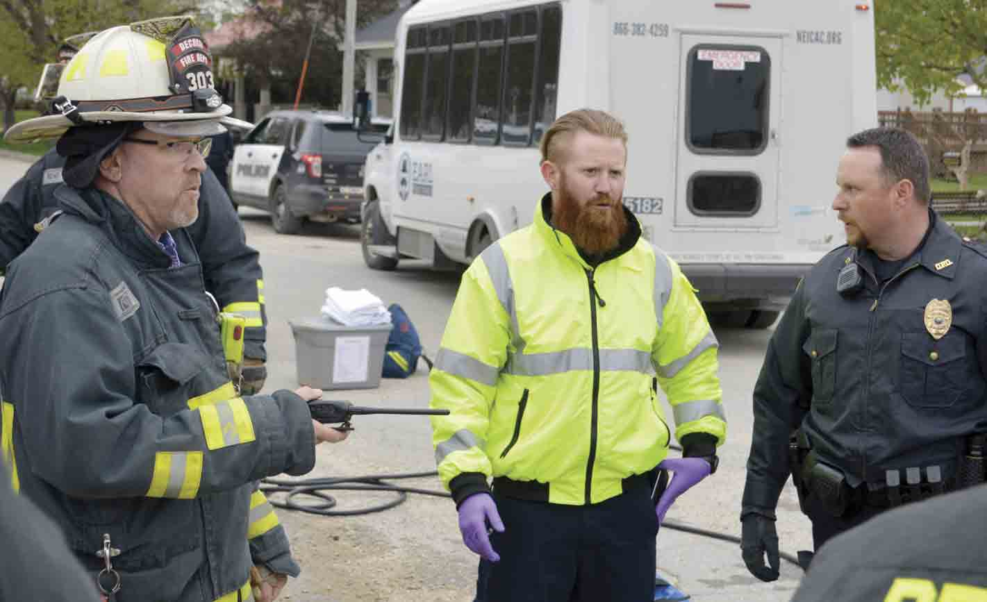 As part of a drill conducted by the Winneshiek Emergency Preparedness Coalition (WEPC), various agencies and emergency response crews, including (l-r) Lee Bjerke from the Decorah Fire Department, Ben Shockey from the Winneshiek Medical Center ambulance crew, and Brent Parker from the...