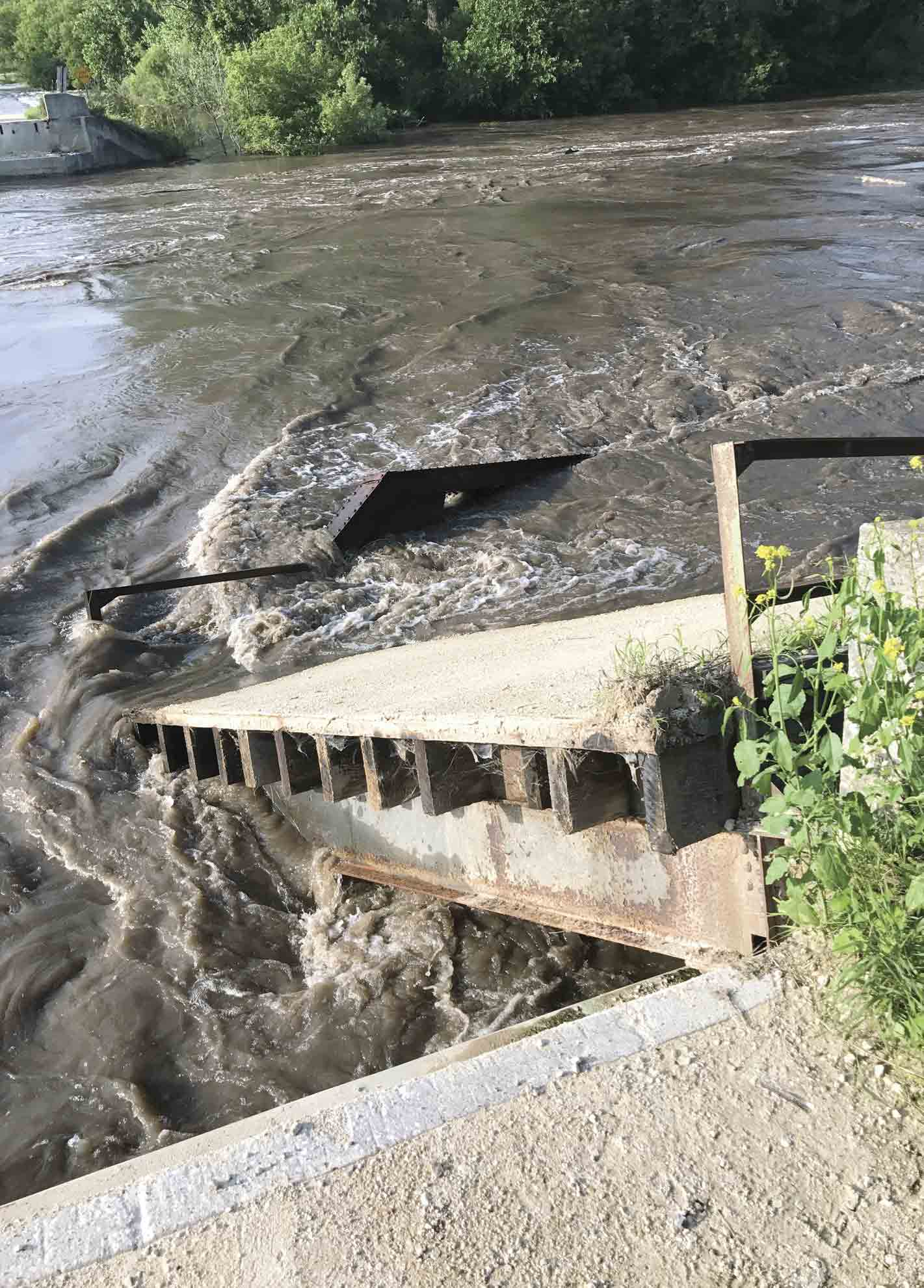 Frey Bridge, located on Acorn Road near Wadena, was completely wiped out by floodwaters Saturday morning. (Zakary Kriener photo) 	$2 million in damage  By Chris Deback	cdeback@thefayettecountyunion.com    Thunderstorms, heavy rain...