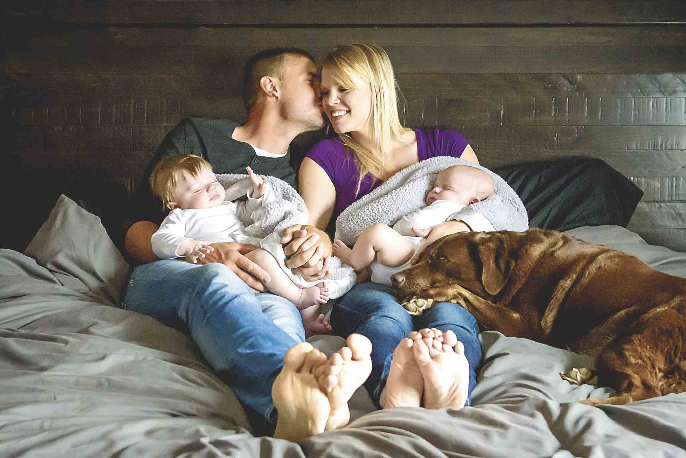 Jax (left) and Bodie Hart snooze peacefully as dad Paul gives mom Erin a kiss. The family dog is never far away. Jax and Bodie are fraternal twins born on Dec. 28, 2016.Photo by Jen Frieden PhotographyThe greatest gift . . . times twoBy Chris...